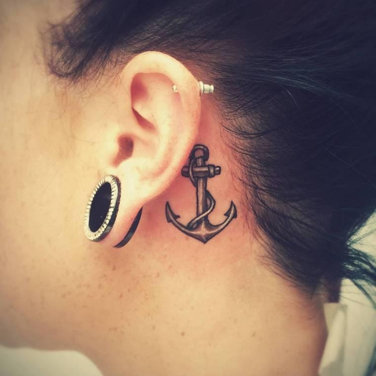 first tattoo woman anchor behind ear