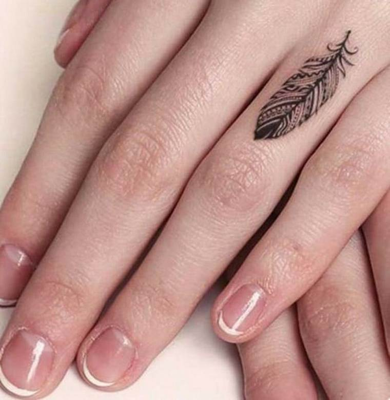 first tattoo woman feather