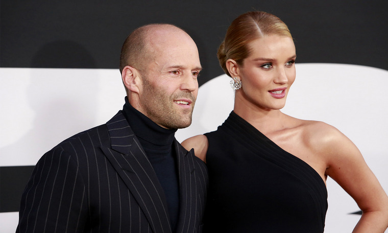 bald man with the most beautiful women