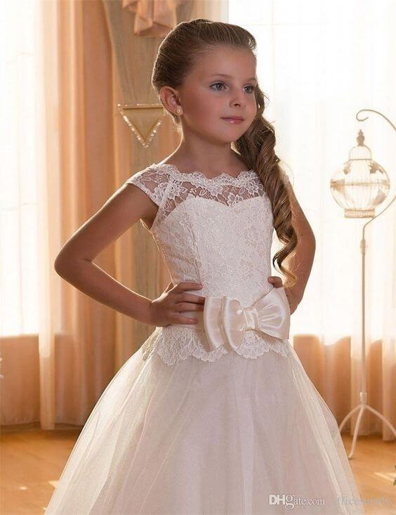 first communion hairstyles low ponytail