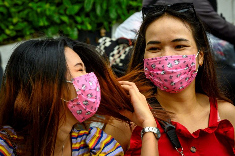 smile behind coronavirus mask