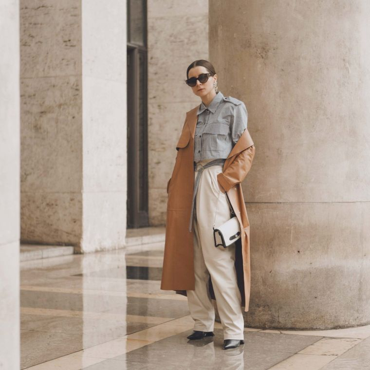 wide pants worn with a trench