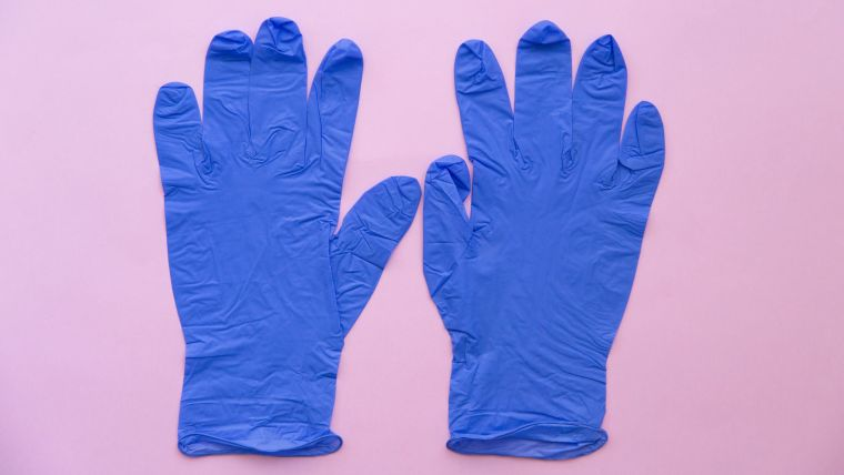 wearing anti-coronavirus gloves