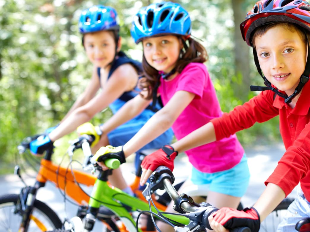 kids with bicycle helmets