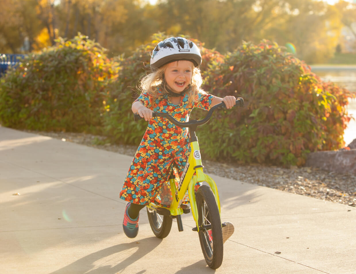 a girl learns to ride a bike