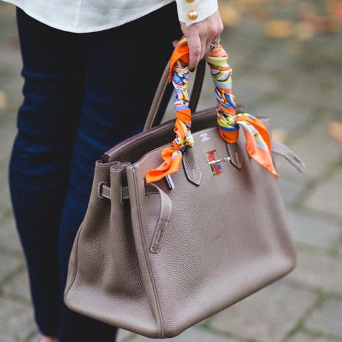 Hermes scarf on the bag handle