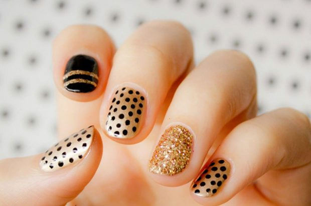 gold nails with black pattern