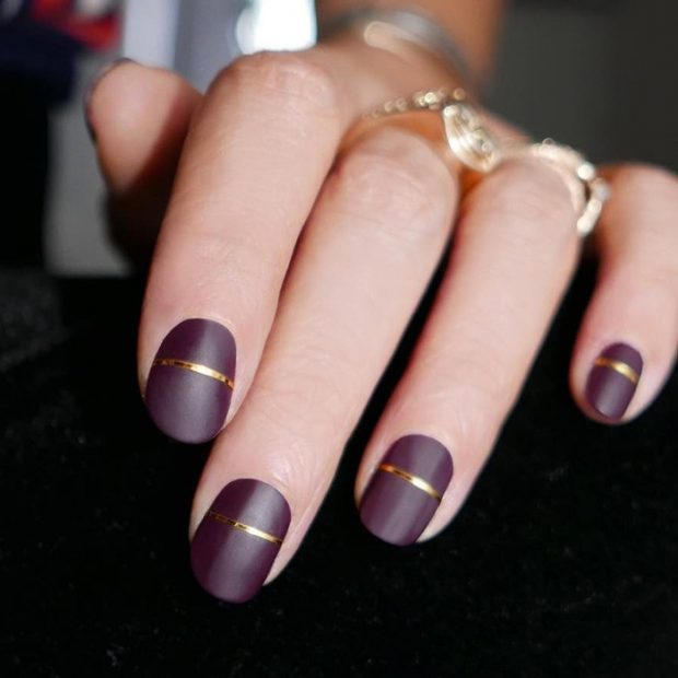 burgundy manicure with stripes