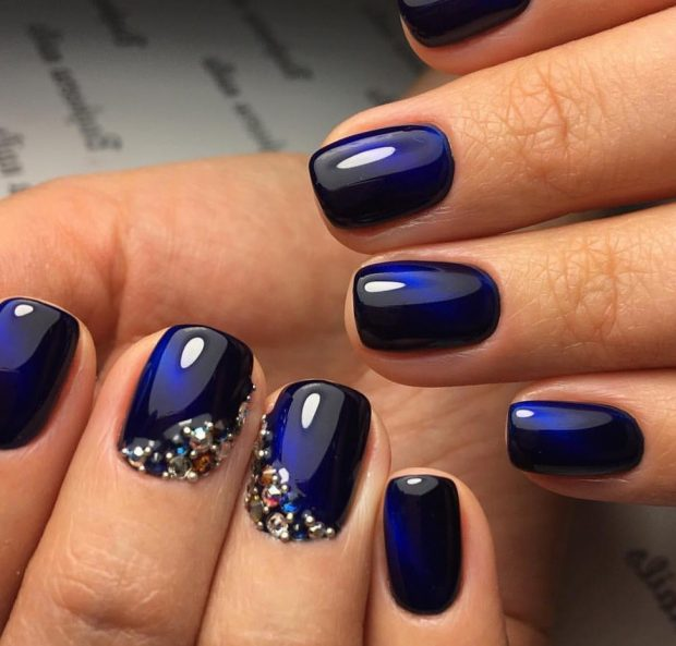 blue manicure with stones