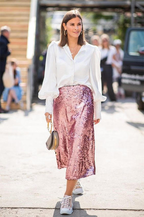 Mix of styles: sneakers and a skirt with sequins