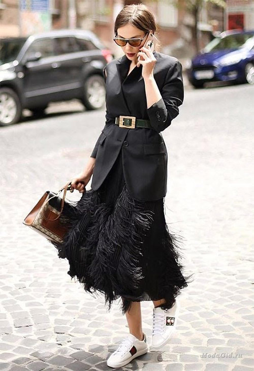 Mix of styles: feather skirt, jacket and sneakers