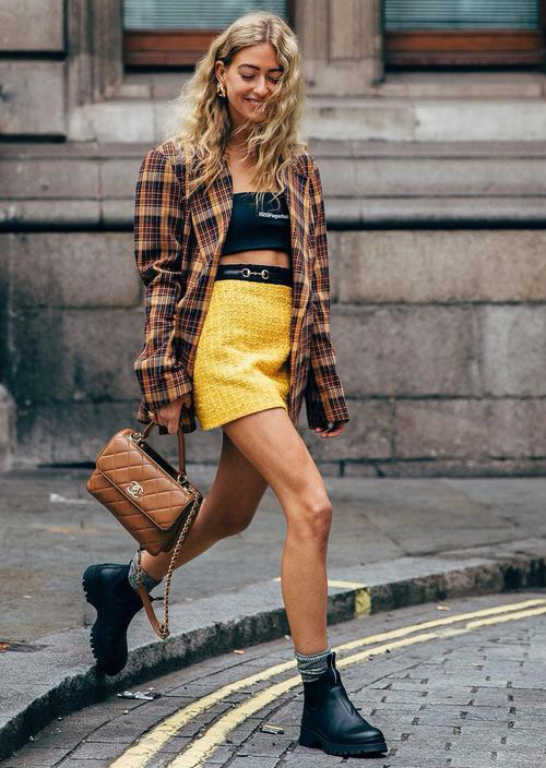 Yellow miniskirt paired with top and plaid shirt for Summer 2021