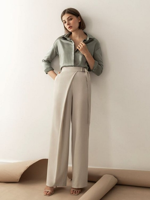 Beige palazzo pants paired with a blouse