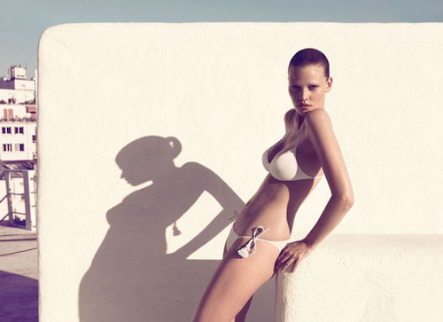 Lara Stone in beige swimwear