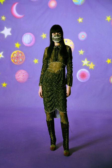 The face mask echoes the look in the Anna Sui collection