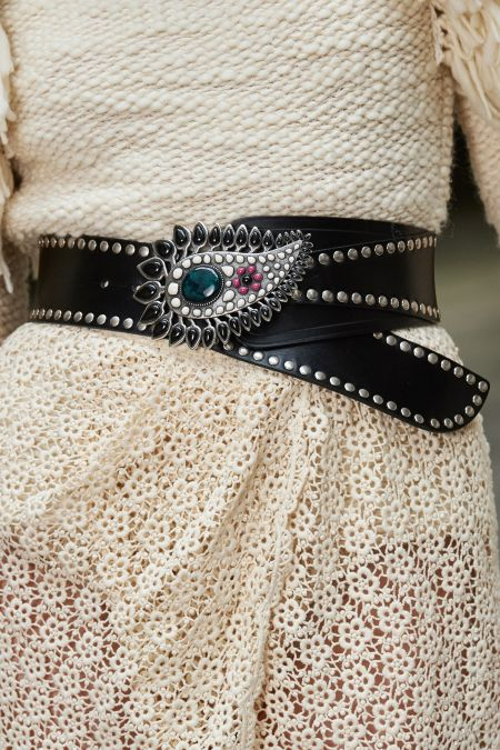 Black belt with rivets and openwork buckle