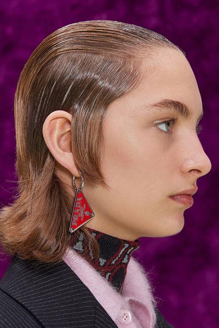 Prada logo earrings in red
