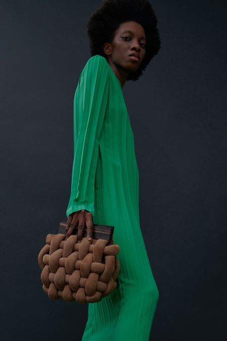 Brown wicker bag with wooden handles