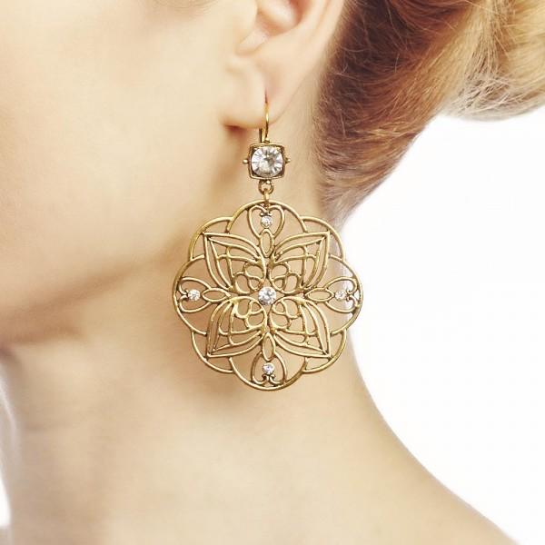ARMADURA URBANA earrings add femininity and charm to your look