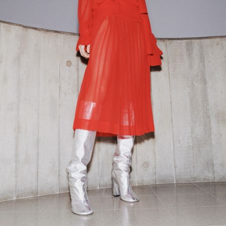 Silver boots with a red dress