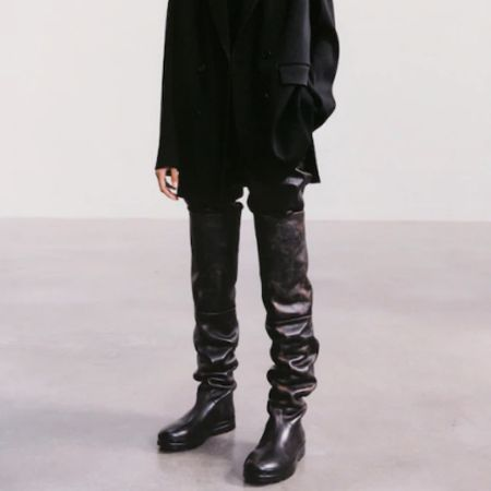 Tall black slouchy boots