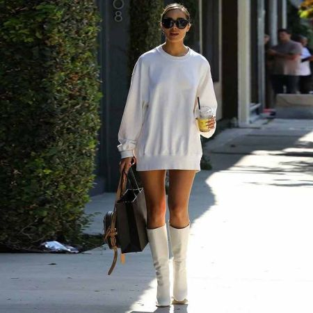 White sweatshirt dress with high white boots