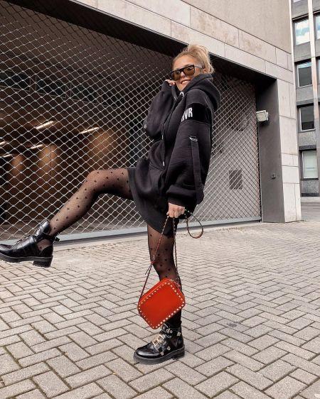 Black sweatshirt dress, black shoes and ginger bag