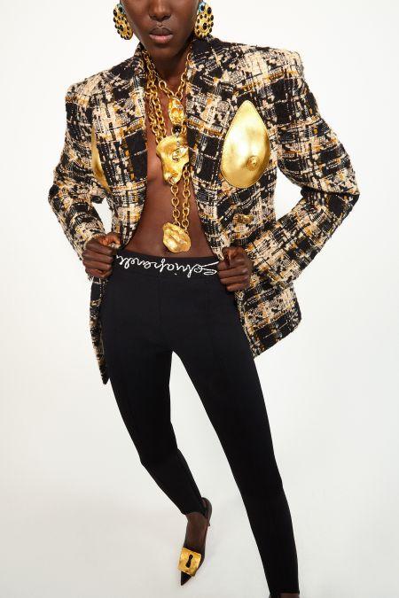 Black leggings, pointed toe shoes and Schiaparelli tweed jacket